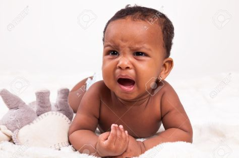 32936686-adorable-little-african-american-baby-girl-crying-black-people-stock-photo