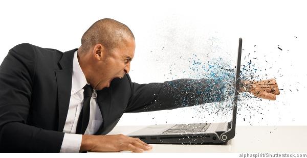 man_smashing_laptop