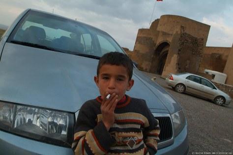 Boy smoking.